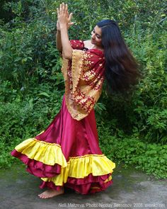 Romani Gypsy dance in native Romani costume. Dancing barefooted Gypsy girl