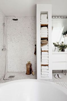 open shower, framed in towel storage