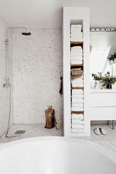 open shower, framed in towel storage