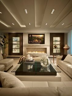 Lovely ivory living room with beautiful lighting and fireplace.