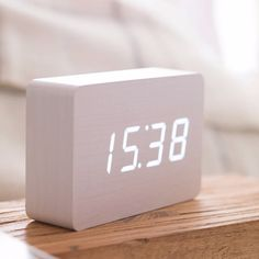 We're all slaves to time, but now it's on your terms with this British designed and quality made Rechargeable Brick White Click Clock. Just click your fingers, clap your hands or gently tap your bedside table and the time, date & temperature will alternately appear for you in white LED colour. It automatically switches off when the room is quiet, lighting up again when the alarm goes off or as a response to your clicked fingers or clapped hands. The numbers seem to float on the lovely wooden…