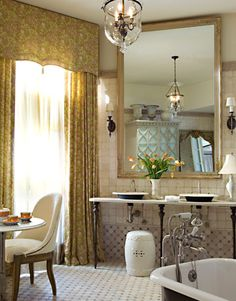 ditto :: an over-the-top luxury bathroom. Love the drapes, the mirror, and the flowers.