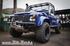 Lifted Blue Land Rover Defender Pickup