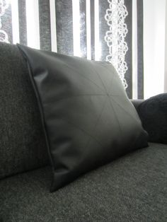 Tee-se-itse-naisen sisustusblogi: Faux Leather Cut Out Of A Pair Of Old TV-chairs As A Cushion Cover