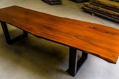 Dining table suitable for 8-10 people 1m average width x 2.9m in length and height of 75cm This rare wood is from a fresh water lake in Panama, submerged underwater since 1913. Finished with natural plant oils and antique wax polish. Metal base custom design and built by Sicot French steel company. Are laminated slabs have wooden dowels within and we only use boat epoxy for glue. Price: $6500 Price is not including base as seen...