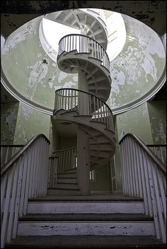 abandoned insane asylum... creepy. but it would be cool if that round piece about the staircase was painted with a map of the world