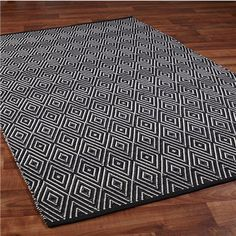 Indoor/Outdoor Concentric Diamond Rug. Many colors. This could work for kitchen or entries. Not sure which color...