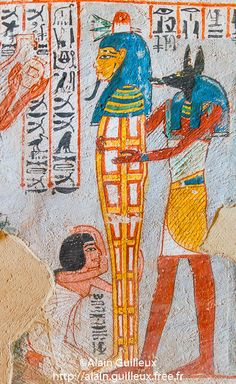 A libation is offered to the mummy of the Osiris Roy. The mummy is held by Anubis or a priest wearing an Anubis mask. | UNESCO World Heritage, Thebes in Egypt, Valley of the Nobles (Dra Abu el Naga), tomb of Roy. A libation is offered to the mummy of the Osiris Roy. The mummy is held by Anubis or a priest wearing a mask of Anubis.        19th dynasty, Abou, Action, Ancient Egyptian Art, Ancient Egyptian Religion, Animal, Art, Clothing and Accessory, Color Image, Cultural heritage, Divinity…