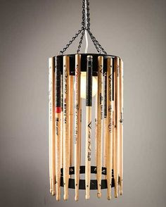 Consisting of only recycled drumsticks and a metal frame this pendant lamp is open and light. The sticks are all used and signed by hard rock bands. A must have for every music fan, try to make yours! #recycled #drumstick #pendant #lamp #music