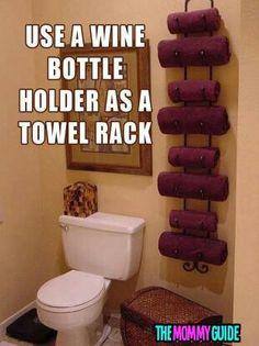 Wine bottle holder as towel rack