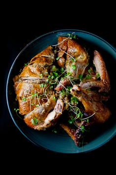 Roast Chicken Stuffed Under the Skin~T~ This recipe is delicious and great for a dinner party. The stuffing is made from garlic, shallots, mushrooms, chestnuts, pine nuts. truffle if you have it, Cognac, panko, fresh herbs and butter. Once you prepare the stuffing you put it in a piping bag and pipe it under the skin. Serve with a pan jus made from pan drippings.