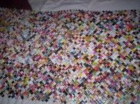 http://www.cutoutandkeep.net/projects/recycled-magazine-wall-art - like the gum wrapper chains we made as kids.  sewn together in rows - how cool!