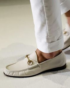 Cuffed white pants, no socks, ivory Ferragamo loafers in soft leather.