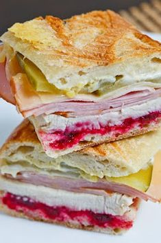 We need to file this away for the day after Thanksgiving! Roast Turkey Cuban Sandwich - dijon mustard, cranberry sauce, roast turkey breast, swiss cheese, and smoked ham. It's the cranberry sauce that makes it so good!