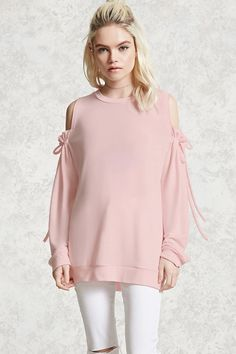 A soft knit top featuring a crew neckline, an open-shoulder design with self-tying long sleeves, and ribbed trim.