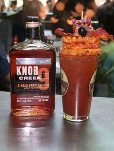 Who says you can't put bourbon in a Bloody Mary? This is a delicious riff on the classic Bloody Bull (Bloody Mary made with beef broth) featuring Knob Creek bourbon, homemade Bloody Mary mix, beef broth and A-1 sauce. Garnish with a slew of pub-friendly finger food. 1.5 oz Knob Creek bourbon 3 oz beef broth 3 oz Bloody Mary mix Splash of Worcestershire sauce Splash of A1 Steak Sauce Garnishes: 2-3 large waffle fries, 1-2 slices of cooked bacon, skewered black olive, 2-3 slices of rolled…