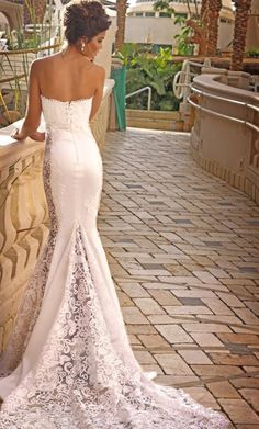 Slim Fitted Strapless Wedding Dress. I love that it's a mix between satin and appliqued lace.