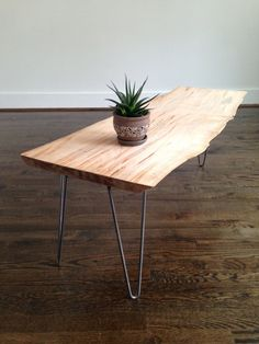 Live edge maple slab coffee table on steel hairpin legs. The Edison Coffee Table is modern and rustic all in one. Measurements: 41.5 L x 17.5 W x 17 H. Now available on Etsy!