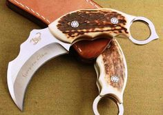 Key West Knife Works - Limited Edition: Kuku Macan Claw Fixed Karambit Knife Blade Staghorn Scales, $89.95 (http://www.keywestknifeworks.com/limited-edition-kuku-macan-claw-fixed-karambit-knife-blade-staghorn-scales/)