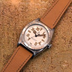 """A 1956 Rolex Bubbleback Ref. 5915 stainless steel watch with a machined bezel and silver, roman arabic """"California"""" Dial with tan luminous markers. While the origin of the term, """"California dial"""". Army Watches, Rolex Watches, Vintage Rolex, Vintage Watches, Modern Watches, Watch 2, Watch Companies, Famous Brands, Stainless Steel Watch"""