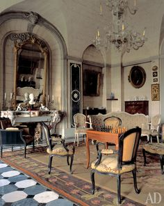 Architecture 101 - Château de Barbentane, France. Beautiufl, chic and original black painted Louis xv fauteuils, mixed with white ones. Good for chess!