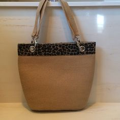 Straw Shoulder Bag with Animal Print Trim Perfect for Summer. Straw shoulder bag. Metallic clasp with one zippered pocket and two accessory pockets inside. Bags Shoulder Bags