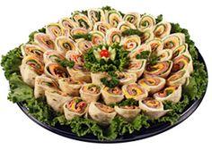 Catering idea: Jason's Deli (pinwheel sandwiches, fruit & cheese platters, pasta entrees, salads, snacks. Vegetarian-friendly.) http://www.jasonsdeli.com/sites/default/files/menus/jasons_deli_catering_03.pdf
