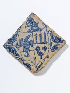 Tile      Place of origin:      Barcelona, Spain (made)     Date:      ca. 1500-1530 (made)     Artist/Maker:      Unknown (production)     Materials and Techniques:      Tin-glazed earthenware     Credit Line:      Given by J.H.Fitzhenry, Esq.     Museum number:      C.234-1911