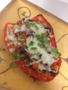 Quinoa and Black Bean Stuffed Peppers: Here's vegetarian update on a vintage comfort food: stuffed peppers. The ground meat is out, and in its place is a hearty, protein-rich combo of quinoa and black beans seasoned with a smoky Southwestern spice blend.