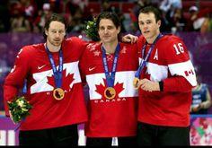Blackhawks' Gold. Duncan Keith, Patrick Sharp, and Jonathan Toews.