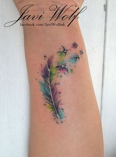 Watercolor feather. Tatooed by @javiwolfink