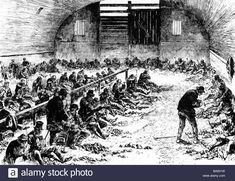 WORKHOUSE Paupers breaking stones in a British workhouse in the 1850s Stock Photo