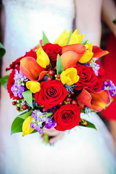 Tulips, roses and calla lilies make up this colorful wedding bouquet.
