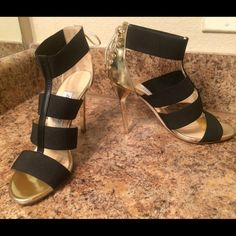 HUGESALEJIMMY CHOO HEELS ALWAYS AUTHENTIC✅. NO TRADES!NOPP. Comes in shoe box with everything. Good condition. Sexy gold tie & bow details in back with black straps in front. gold stiletto heel. Very comfortable on the black straps are elastic Jimmy Choo Shoes Heels