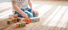3 year old child plays with wooden cubes with colorful letters on the floor in the room a little girl is building a tower at home or in the kindergarten. Educational toys for young children. Helping Children, Young Children, Types Of Play, Physical Skills, Wooden Cubes, Oldest Child, Toys Shop, Working Moms, Child Development