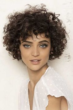 Attractive Young Lady Tanned Skin Short Haircuts Curly Hair Gray Eye Color Large Volume Medium Thickness Casual Clothing