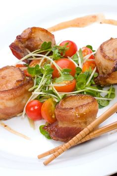 """These scallops wrapped in bacon are easy party appetizers and your guests will love them. For the best flavor, ask for """"dry"""" sea scallops rather than wet ones. These have not been treated with a shelf life prolonging solution and will brown better. They also have a better flavor, texture, and taste fresher than the treated ones. You can soak them in water for an hour before making this sea scallops wrapped in bacon recipe to remove any salt solution."""