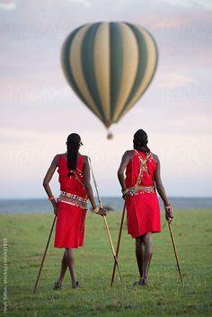 Maasai tribesmen in the Maasai Mara National Park. Kenya. Africa. by Hugh Sitton