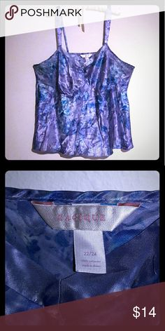 Cacique Silky Purple & Blue Cami Top, Size 22/24 + Surprise freebies with every purchase! + EUC Excellent condition, no signs of wear.  This beautiful Cacique brand camisole top features a purple and blue abstract floral print. Very soft and silky look and feel. Can be worn as sleepwear/lingerie or as a tank under a jacket or sweater. Adjustable spaghetti straps.  Woman's Size: 22/24  * Bundle 3 or more listings and save 15% * Cacique Tops Camisoles