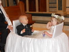 Someone pulls the flower girl and ring bearer down the aisle :)
