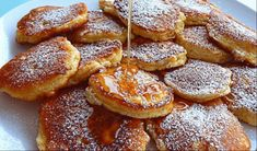 Το τέλειο συνοδευτικό για το πρωινό σας, καθώς μπορούν να σερβιριστούν είτε σκέτες, είτε με γλυκούς συνδυασμούς, είτε με αλμυρές γεύσεις. Υλικά (40-45 Μηλοτηγανίτες) 2 αυγά 230 g αλεύρι 2 κΓ. baking powder 200 g γάλα 3 κ.σ. ζάχαρη μια τσιμπιά αλάτι 3 μήλα 1 λεμόνι, το ξύσμα λάδι ελαφρύ, για τηγάνισμα ζάχαρη άχνη, για [...] Greek Sweets, Greek Desserts, Greek Recipes, Breakfast Snacks, Breakfast Recipes, Crepes And Waffles, Fast Easy Meals, Apple Recipes, Food Inspiration