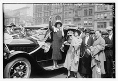 """Part 3 of our blog series """"Traveling for Suffrage."""" This post details the women who flew across the country to fight for their right to vote.  Image: Rosalie Jones (center) greeting a crowd with fellow suffragists. Courtesy of Library of Congress, Prints & Photographs Division [LC-DIG-ggbain-37542]."""