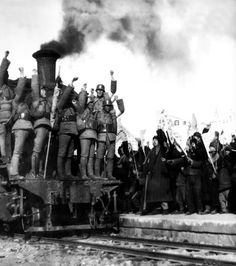 Crowds gather at the railway station to cheer for the Chinese soldiers of the 179th Brigade as they depart for the front lines to fight agai...