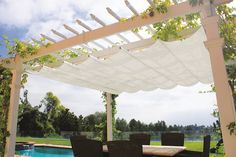 Pergola accessories can enhance your backyard pergola for year-round enjoyment. A retractable pergola canopy can be added to our standard size Big Kahuna pergola kits to create a shady beautiful patio pergola. Pergola With Roof, Pergola Lighting, Retractable Pergola Canopy, Diy Canopy