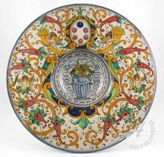 Italian wall plate by Marco e Vasco Bertini (Firenze). This is gorgeous stuff. And so much information about Italian ceramics on this website.