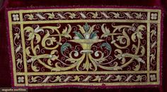 Red velvet w/ embroidered front & back panel in Renaissance design, (fold & stitch marks in velvet) very good; t/w 1 red velvet 17th C. chasuble fragment w/ polychrome & gold embroidered saints in rondels, fair