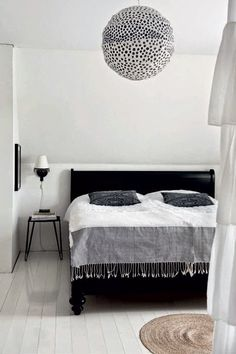 The striking monochrome home of a Swedish photographer. Magdalena Björnsdotter. black and white barefootstyling.com