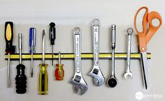 Hang up a magnetic strip to hold screwdrivers, wrenches, and scissors.