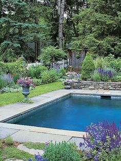 rectangular pool with sloping uphill retaining wall ... on Uphill Backyard Ideas  id=37643