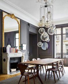 Dark paint. Statement Light. Minimal furniture. ✔